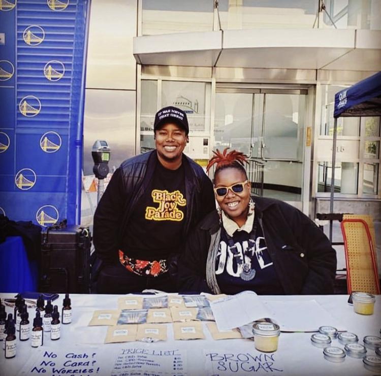 Brown Sugar Botanicals founders tabling at Black Joy Parade